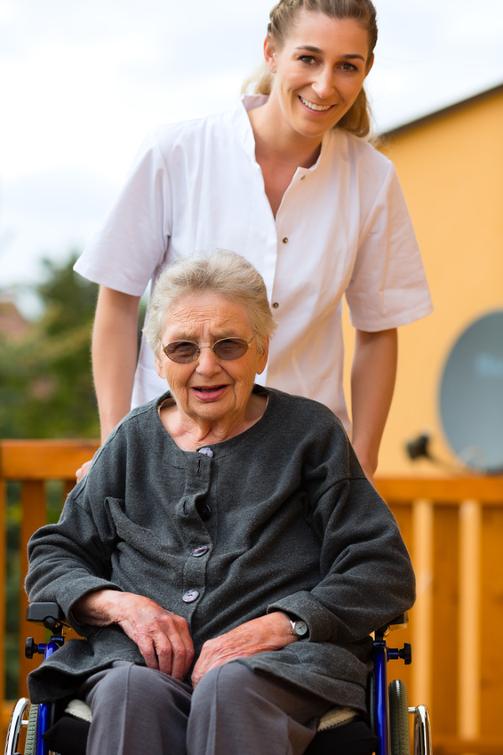 Young nurse and female senior in a wheel chair